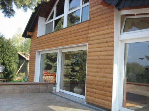 Fassadenverkleidung mit Lärche Blockhausprofil
